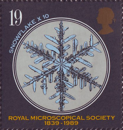A snowflake under a microscope on a 19 pence stamp.