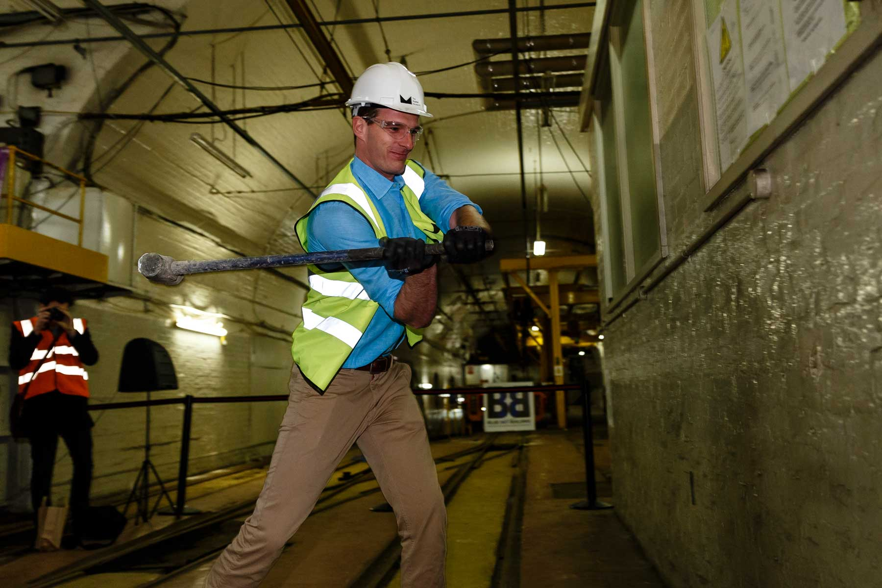 Dan Snow gets to work in Mail Rail with a sledgehammer