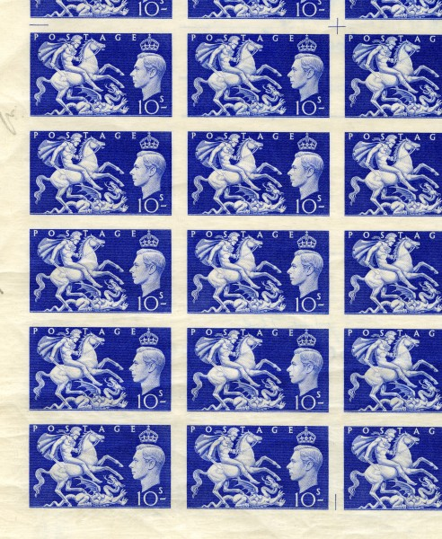The corner of a sheet of 10s King George VI stamps in blue accompanied by St George and the Dragon