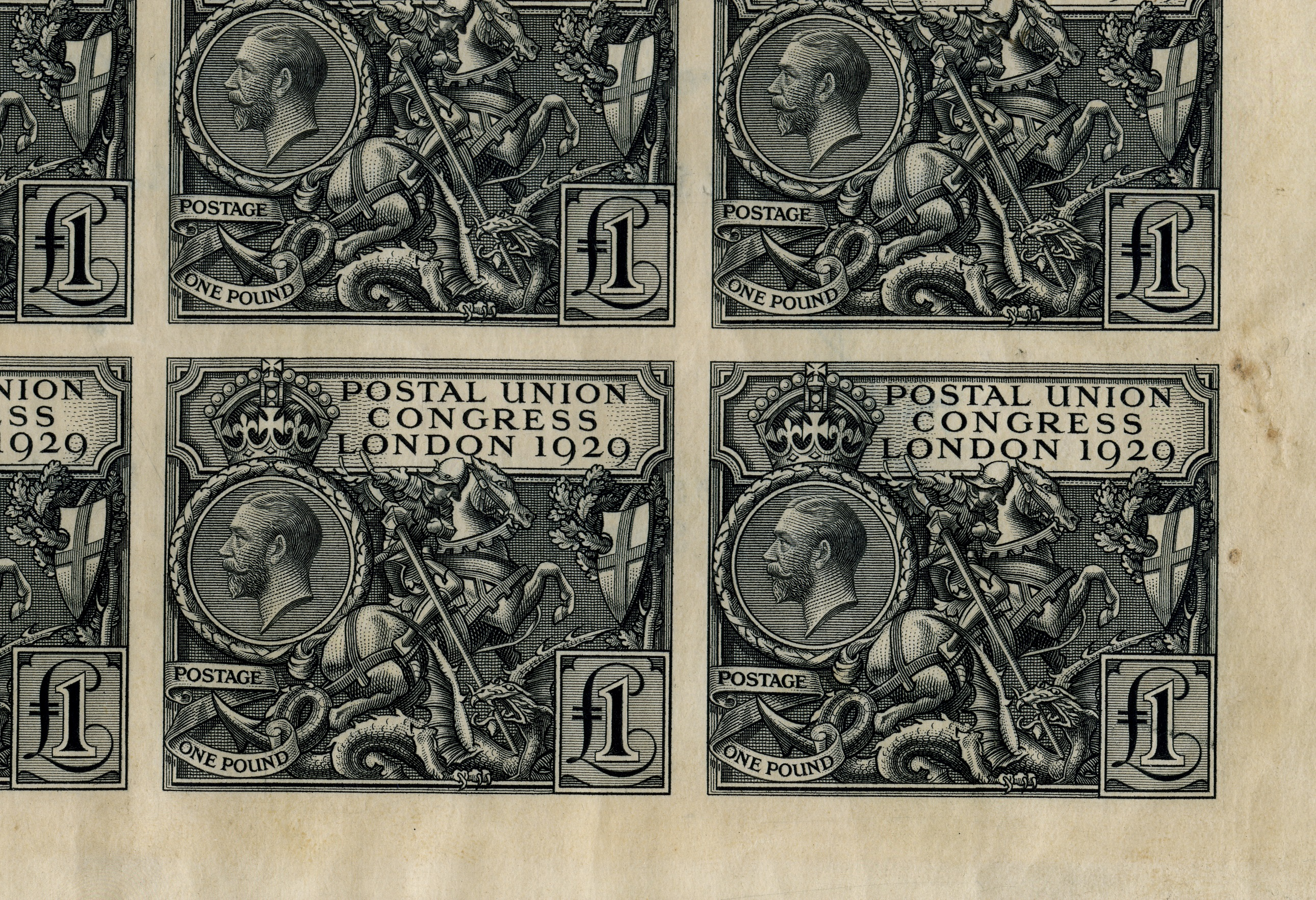 The corner of a sheet of £1 stamps of King George V with an image of St George and the Dragon