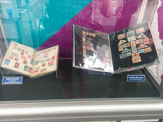 The display case at Stampex with both the John Lennon and Freddie Mercury stamp albums within.