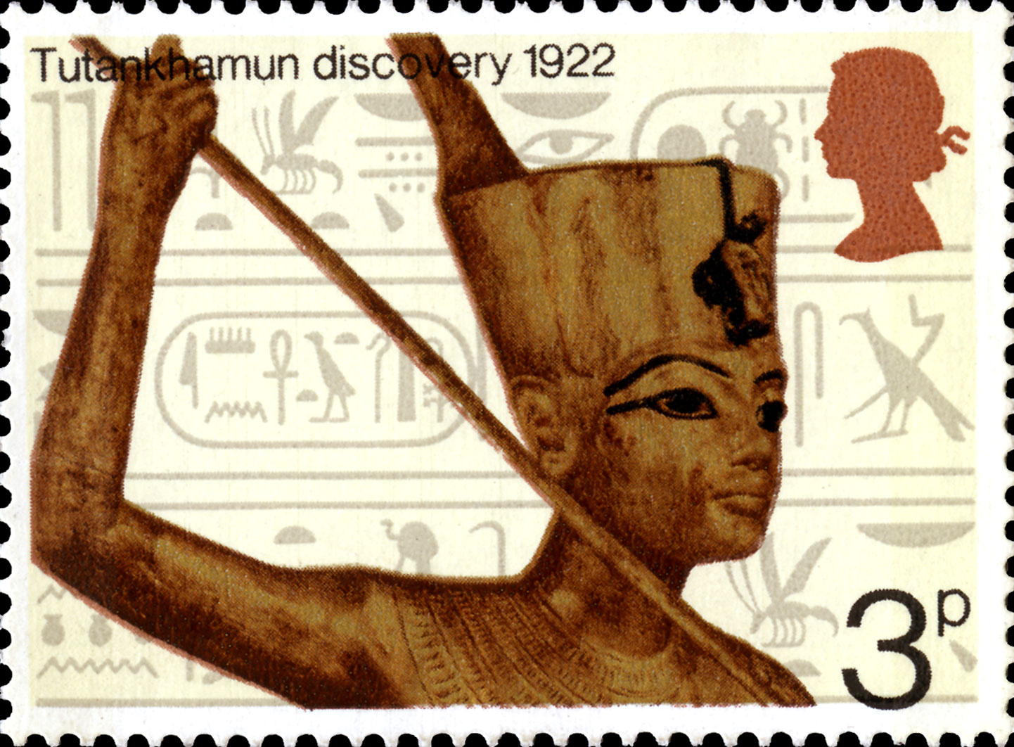 Stamp depicting a statue of Tutankhamun against a background of Hieroglyphics.