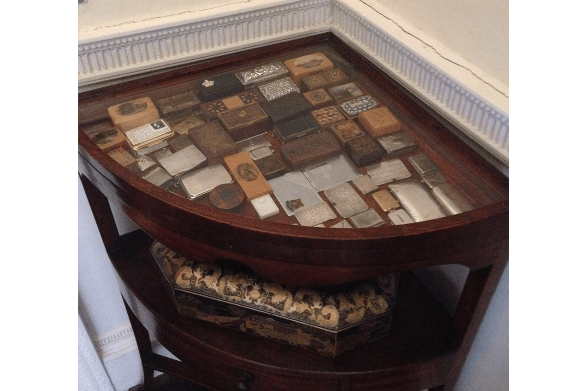 A desk with stamp boxes on show under the glass top
