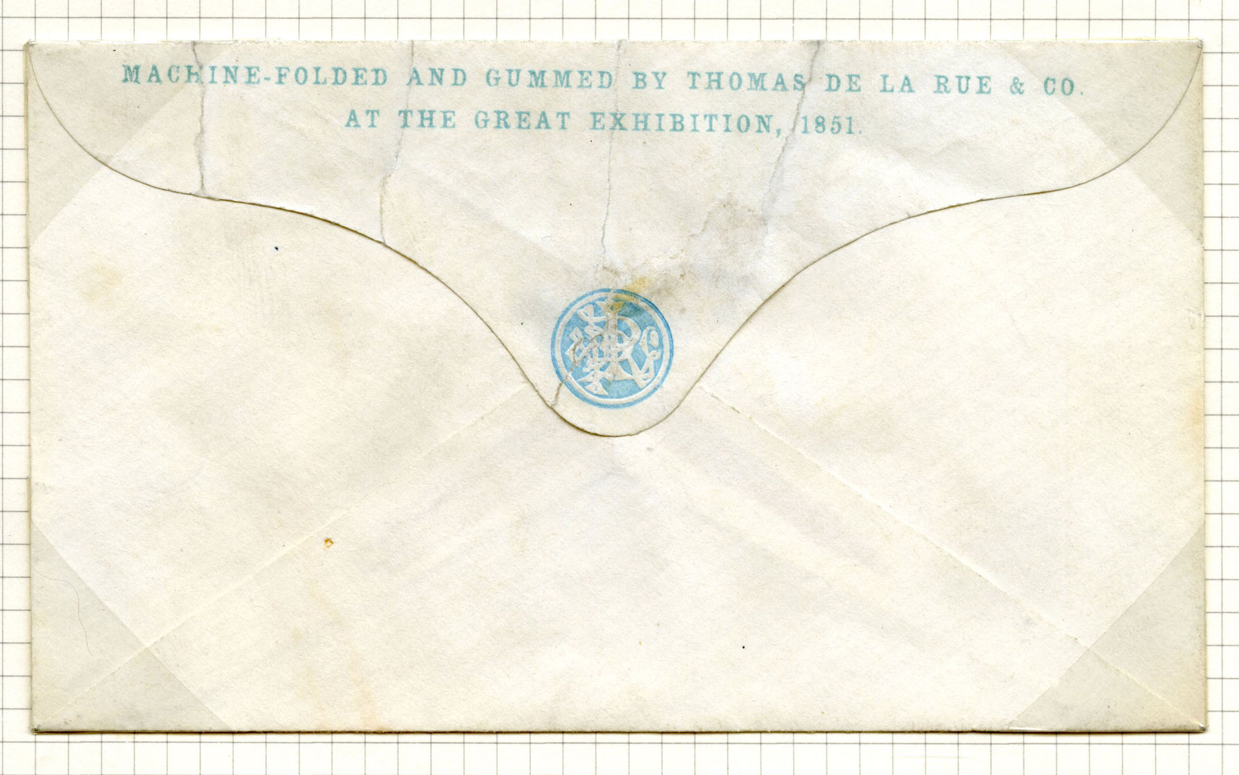 Folded envelope inscribed along the top 'Machine folded and gummed by Thomas De La Rue & Co. at The Great Exhibition, 1851'.