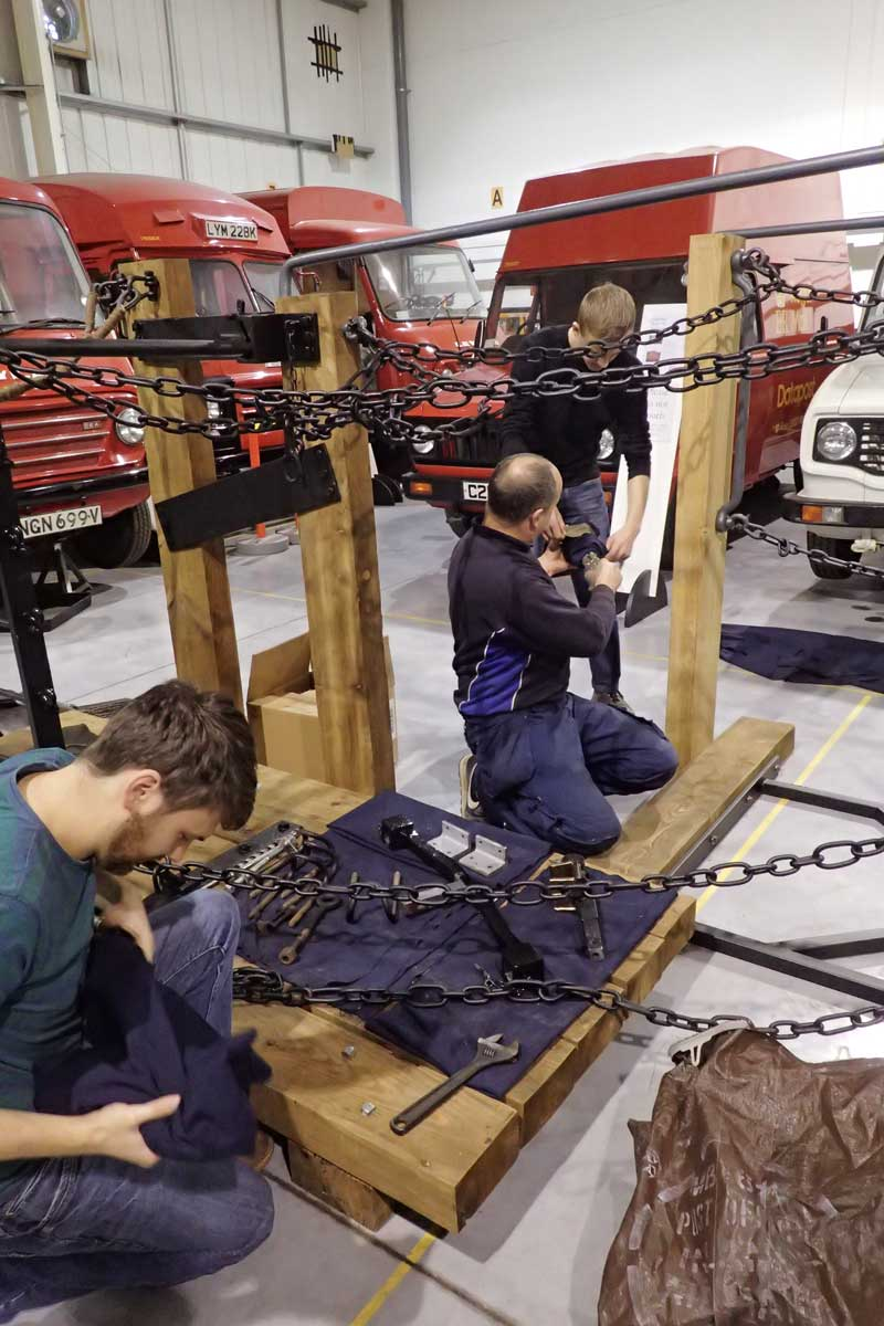 Phil Marshal and Joel Fletcher Hawkins of the Nene Valley Railway laying out the chains during the reconstruction of The Postal Museum's Bag Exchange Apparatus at the Museum Store, Debden