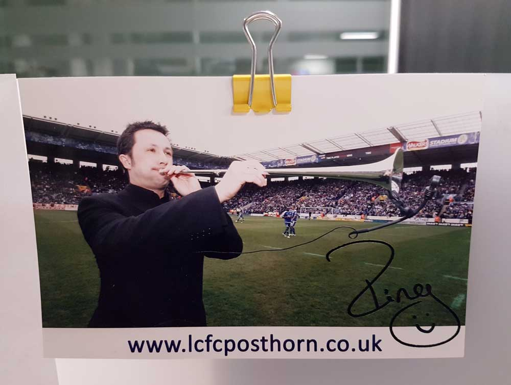 Signed photograph of Paul Hing playing the Post Horn at a Leicester City FC game