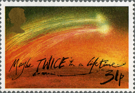 A stamp depicting an image of a comet with the words 'maybe twice in a lifetime' written across it.
