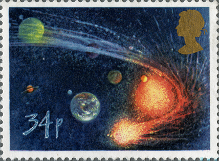 A stamp depicting an image of a comet orbiting the sun producing a tail.