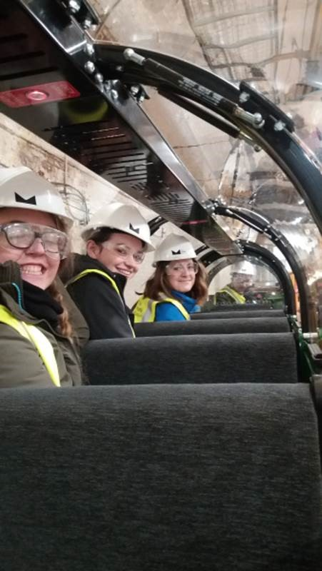 Davide, Lauren (Head of Operations), Tash and Penny learning to drive Mail Rail trains