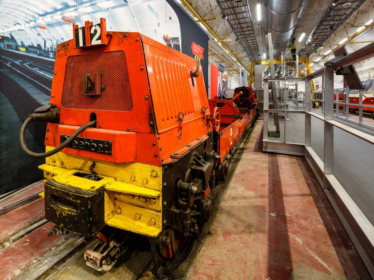 Red and yellow train in Mail Rail exhibition depot