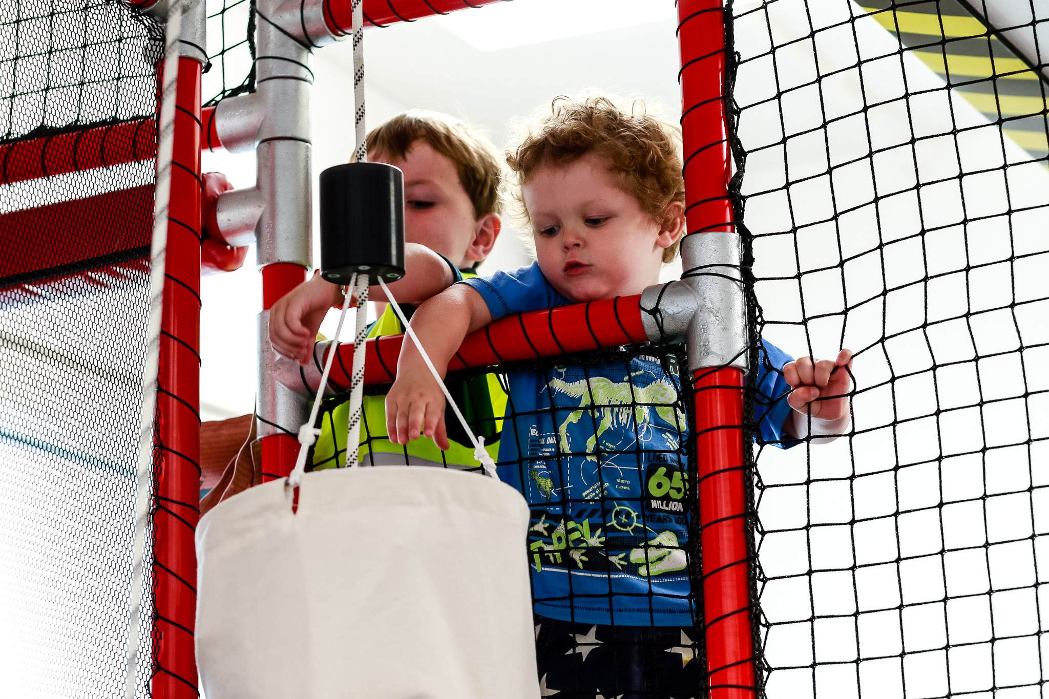 Parcel sorting - Using pulleys and slides, kids can have a go at moving the mail.
