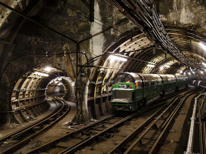 One of our new passenger trains in the Mail Rail tunnels, passing a side-tunnel