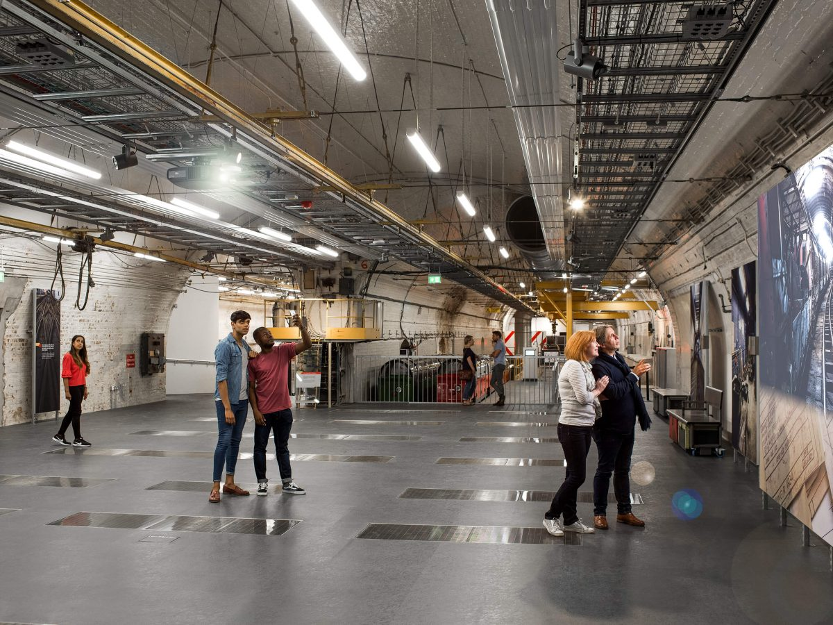 Mail Rail event space featuring five people looking around