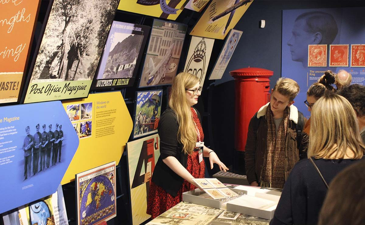 Visitors looking at collection items during a Private tour of the gallery