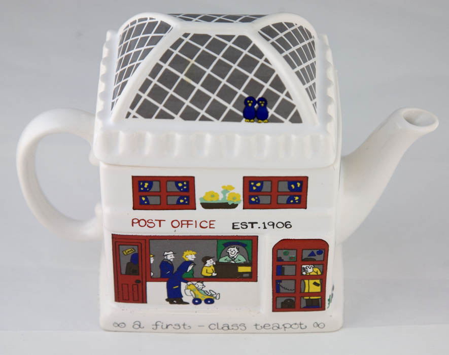 Ceramic teapot decorated to look like a Post Office with customers.