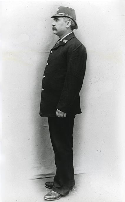 Summer uniform with double peaked shako. London postman of 1904 (POST 118/2060)