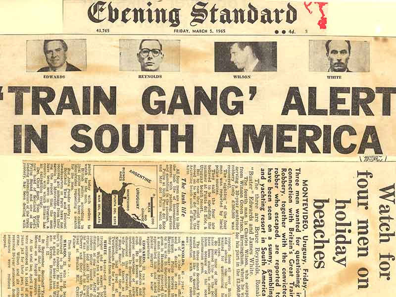 A newspaper front page with the headline: Train gang alert in South America, from the Evening Standard newspaper in 1965.