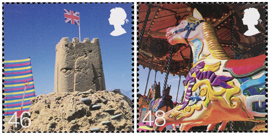 Two stamps depicting a sand castle and a merry-go-round.