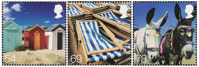Three stamps depicting beach huts, deck chairs and donkeys.