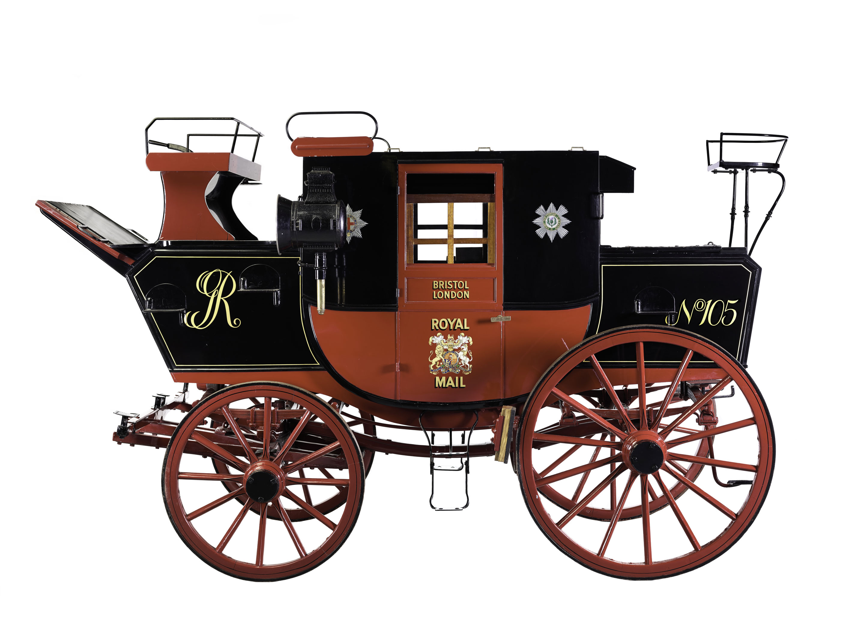 Photograph of the Royal Mail mail coach from c.1800 in red and black.
