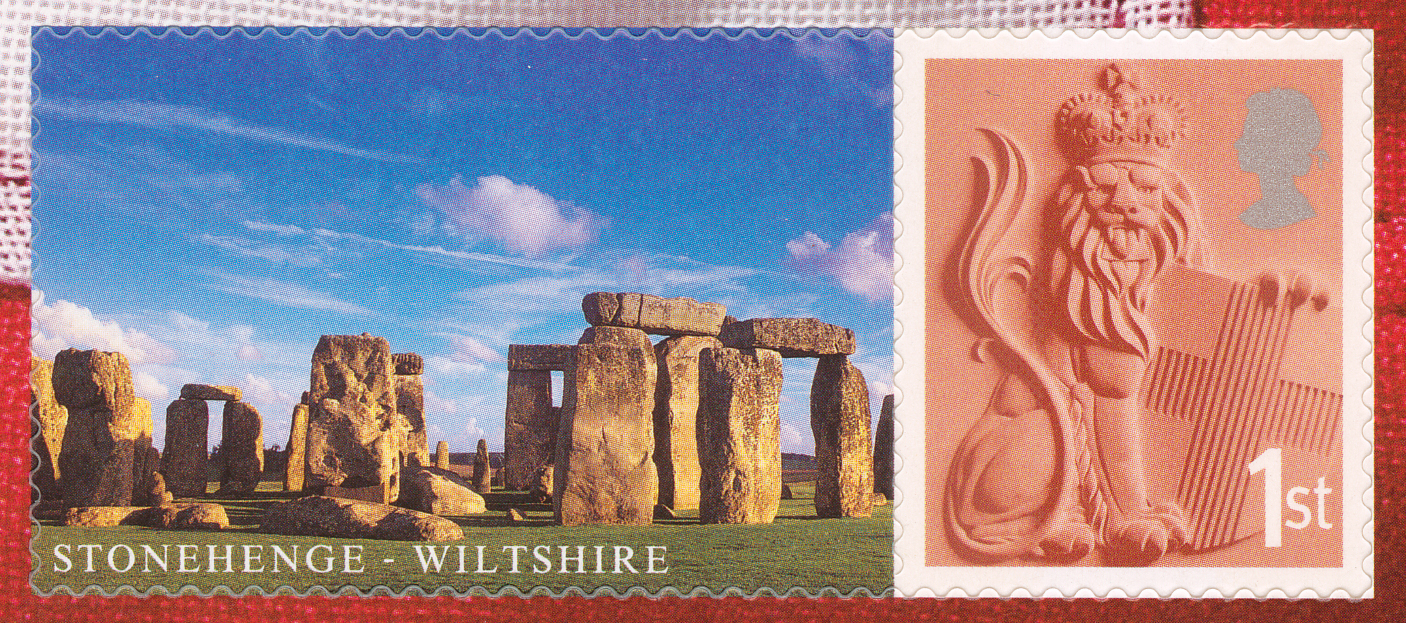 Stamp depicting a lion and a label of Stonehenge.