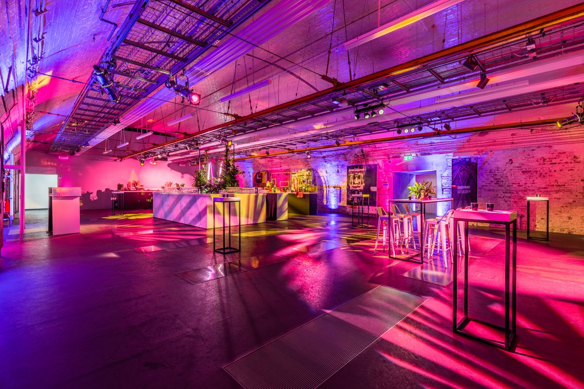 Photo of Mail Rail party space, with lighting and table setup