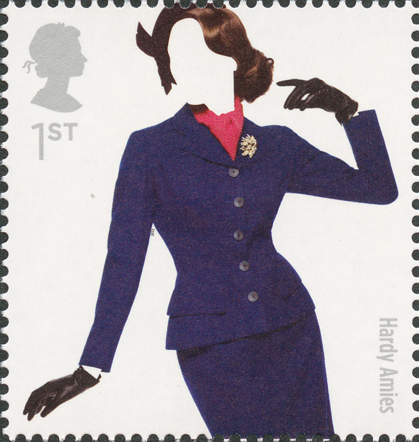 A stamp depicting a model wearing a fitted blue skirt and jacket with brooch.
