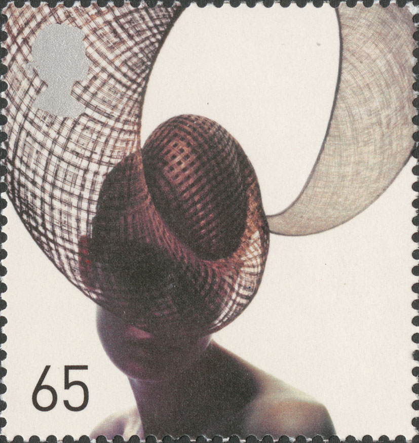A stamp depicting a sweeping mesh hat by Philip Treacy.