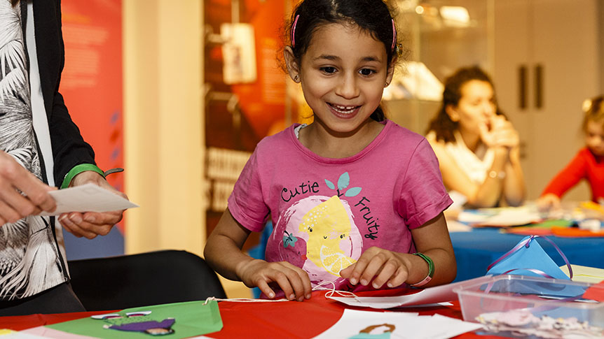 Photo of a girl in a crafting workshop at The Postal Museum.