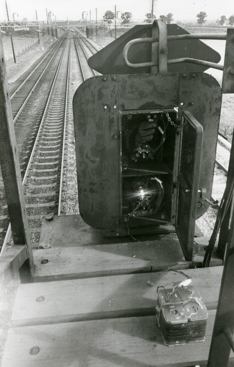 Black and white photograph on the inner workings of a train signal light.