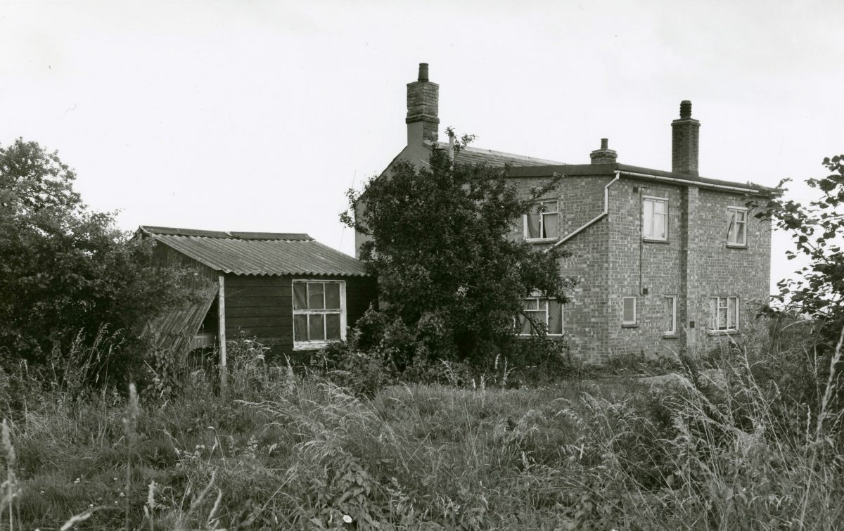 Black and white photograph of the farm of robbers used.