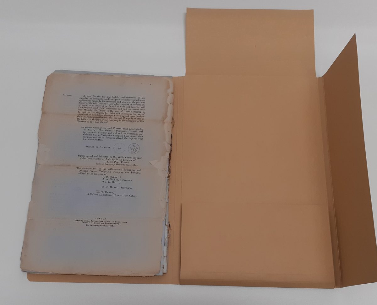 Four flap folder opened to show pages on the left hand flap. Several small tears are shown on the right hand edge of the pages