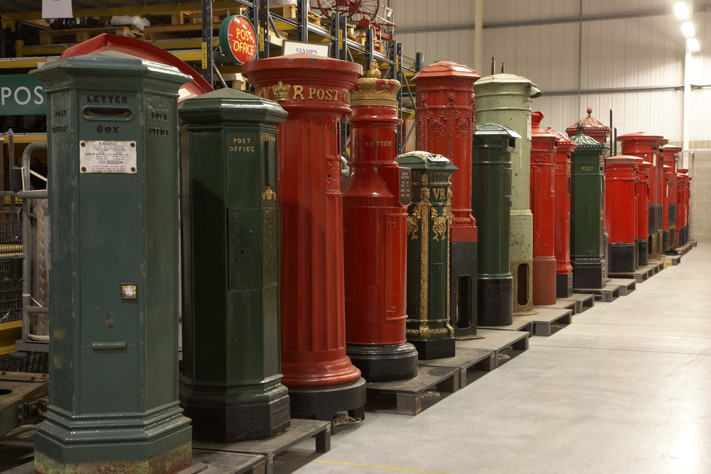 The Postal Museum Store at Debden, near Loughton, Essex. The line of pillar boxes show the development of post boxes from the earliest trials on the Channel Islands in 1852-3 to the modern day.