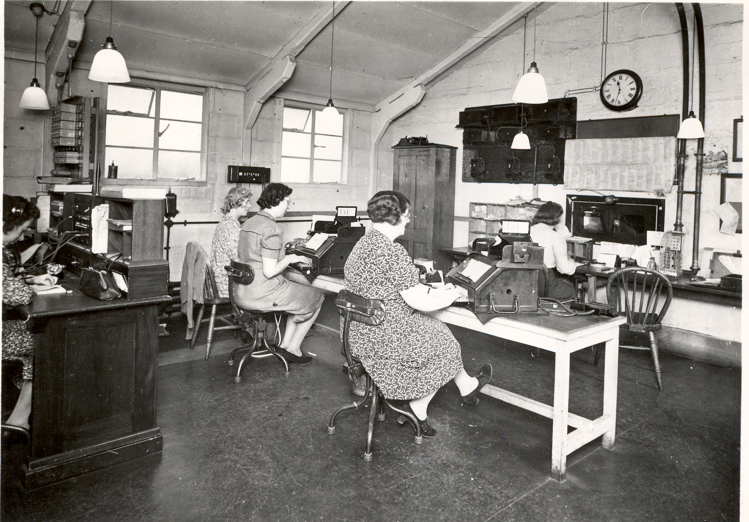 Black and white images of women working at telegraph machines.