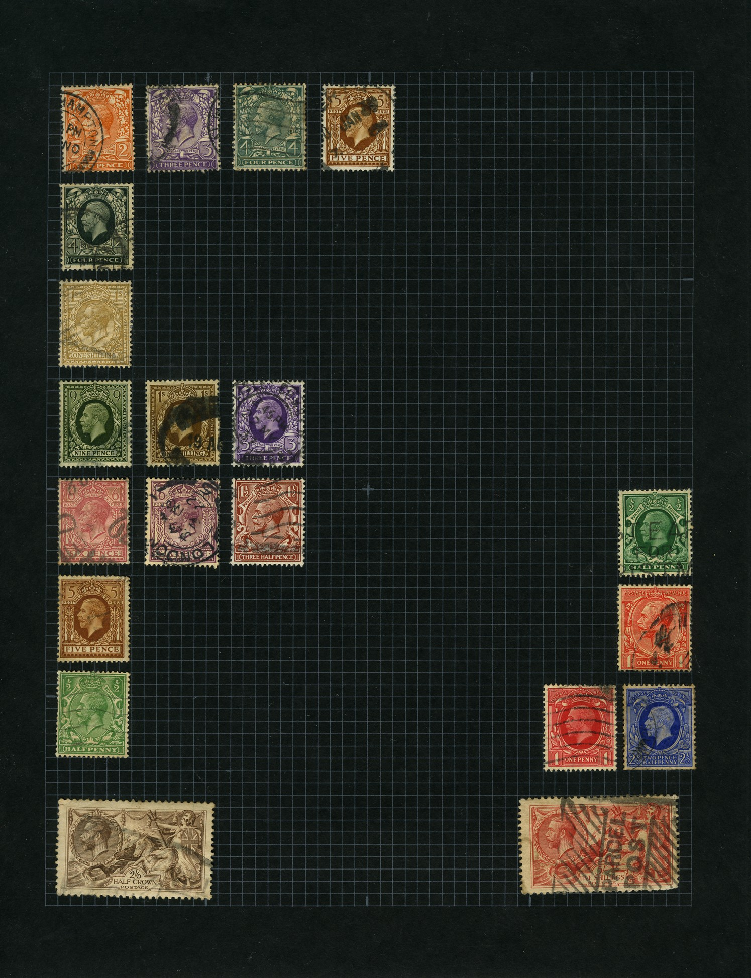 A black album page with mixed coloured stamps affixed in the shape of a letter 'F'.