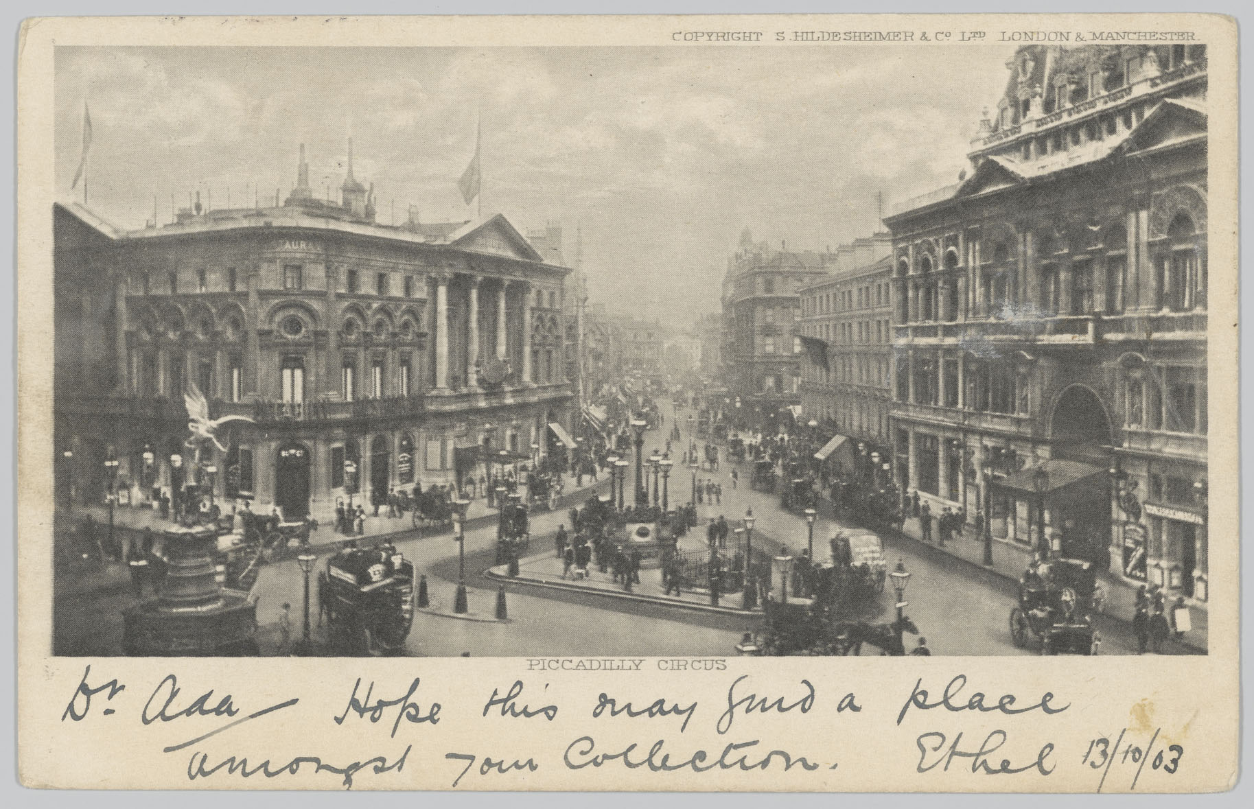 Black and white postcard of Piccadilly Circus with the message written at the bottom.