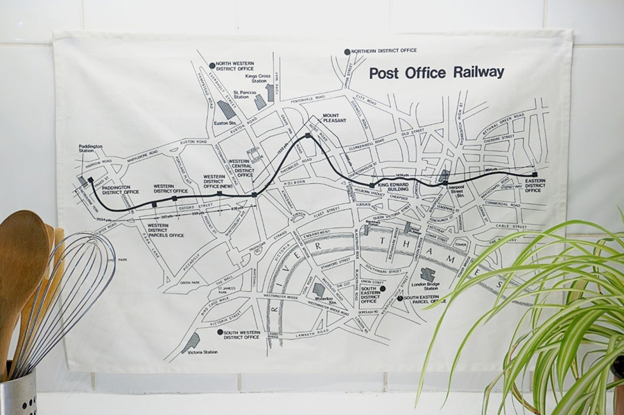 Photo showing a printed tea towel with an old map of the Post Office Railway system.